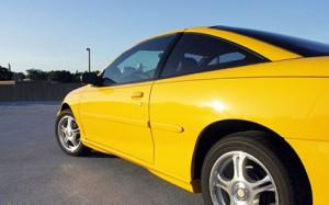 Yellow sports car side angle